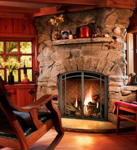 Fire burning in stone fireplace.